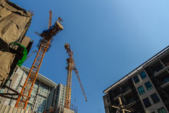 Luffing jib tower crane at condominium construction site over st Royalty Free Stock Photography