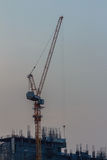 Luffing jib tower crane at condominium construction site over st Stock Photos