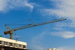 Luffing jib tower crane at large scale construction site over st Stock Photos
