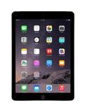 Luft 2 för iPad för Apple utrymmegrå färger med iOS 8 som planläggs av Apple Inc Arkivfoto