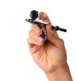 Luft-Pinsel in der Hand Lizenzfreies Stockbild