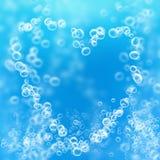 Lufta bubblar i forma av en hjärta Arkivfoto