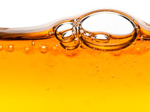 Luftblasen in der orange flüssigen Seife Lizenzfreie Stockbilder