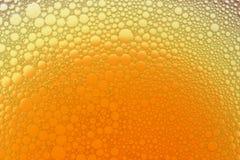 Luftblasen des orange Gelbs Lizenzfreie Stockbilder