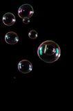 Luftblasen getrennt auf Schwarzem Lizenzfreies Stockfoto