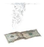 Luftblasen- und Dollarbanknote im Wasser Stockfotografie