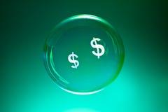 Luftblasen und Dollarzeichen Stockfotografie