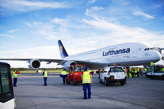 Lufthansa A380 at airport. An Airbus A380 from Lufthansa located at Oslo Airport Gardermoen, Norway. This is the second time an A380 visits Norway and crowds Royalty Free Stock Image