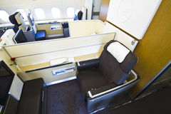 Lufthansa A380 First Class with rose. The first class chair/bed in an Airbus A380 from Lufthansa. The first class is located in the upper floor. The white wall Stock Photo