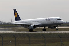 Lufthansa Airbus A321-200 aircraft landing on the runway Royalty Free Stock Images