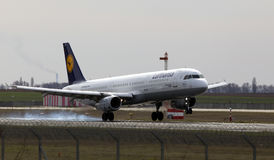 Lufthansa Airbus A321-200 aircraft landing on the runway Stock Photography