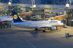 Lufthansa Airbus A320 airplane Dusseldorf airport at night Stock Photos