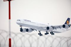 Lufthansa Airbus A340-600 D-AIHV landing in Munich. Airport stock photography
