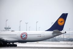 Lufthansa Airbus A340-600 D-AIHZ tale, FC Bayern livery. Lufthansa Airbus A340-600 D-AIHZ doing taxi in Munich Airport, MUC, winter time with snow on runways. FC royalty free stock photography