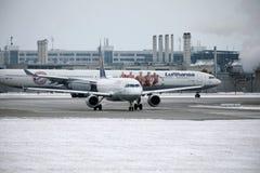 Lufthansa Airbus A340-600 D-AIHZ doing taxi Munich Airport,winter time, FC Bayern livery. Lufthansa Airbus A340-600 D-AIHZ doing taxi in Munich Airport, MUC stock photos