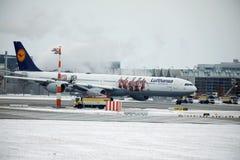 Lufthansa Airbus A340-600 D-AIHZ doing taxi Munich Airport,winter time, FC Bayern livery. Lufthansa Airbus A340-600 D-AIHZ doing taxi in Munich Airport, MUC stock image