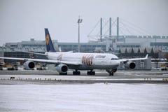 Lufthansa Airbus A340-600 D-AIHZ doing taxi Munich Airport,winter time, FC Bayern livery. Lufthansa Airbus A340-600 D-AIHZ doing taxi in Munich Airport, MUC stock photo
