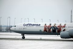 Lufthansa Airbus A340-600 D-AIHZ with FC Bayern livery. Lufthansa Airbus A340-600 D-AIHZ taking off from Munich Airport, MUC, winter time with snow on runways stock photography