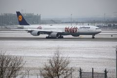 Lufthansa Airbus A340-600 D-AIHZ with FC Bayern livery. Lufthansa Airbus A340-600 D-AIHZ taxiing in Munich Airport, MUC, winter time with snow on runways. FC royalty free stock photography