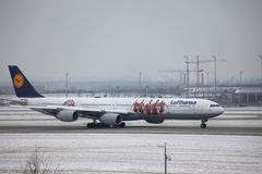 Lufthansa Airbus A340-600 D-AIHZ with FC Bayern livery. Lufthansa Airbus A340-600 D-AIHZ taxiing in Munich Airport, MUC, winter time with snow on runways. FC stock image