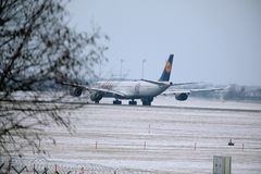 Lufthansa Airbus A340-600 D-AIHZ ready to takeoff from Munich Airport,winter time, FC Bayern livery. Lufthansa Airbus A340-600 D-AIHZ taking off from Munich royalty free stock image