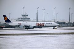 Lufthansa Airbus A340-600 D-AIHZ taxiing in Munich Airport,winter time, FC Bayern livery. Lufthansa Airbus A340-600 D-AIHZ doing taxi in Munich Airport, MUC royalty free stock photo