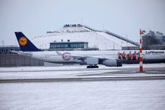 Lufthansa Airbus A340-600 D-AIHZ taxiing in Munich Airport, winter time, FC Bayern livery. Lufthansa Airbus A340-600 D-AIHZ doing taxi in Munich Airport, MUC stock image
