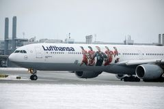 Lufthansa Airbus A340-600 D-AIHZ taxiing in Munich Airport,winter time, FC Bayern livery. Lufthansa Airbus A340-600 D-AIHZ doing taxi in Munich Airport, MUC stock photography