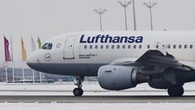 Lufthansa Airbus A319-100 D-AILD taxiing in Munich Airport MUC. Lufthansa Airbus A319-100 D-AILD in Munich Airport MUC, winter time with snow on runway. Jet stock footage
