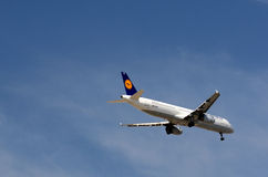 Lufthansa Airbus descending. Lufthansa Airbus Plane descending for landing Royalty Free Stock Photo