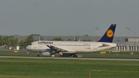 Lufthansa Airbus doing taxi Munich Airport. Air traffic control tower on background stock footage