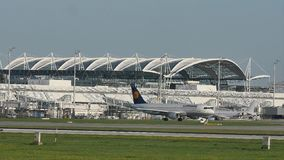 Lufthansa Airbus doing taxi Munich Airport. Air traffic control tower on background stock video