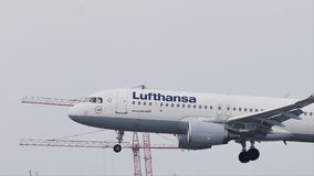 Lufthansa Airbus landing on Munich Airport, MUC, snow. Lufthansa Airbus jet landing on snowy runway in Muenchen Flughafen, Germany stock video footage