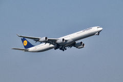 Lufthansa Airbus A340-642. Labeled D-AIHP take off at Frankfurt Airport Royalty Free Stock Photos