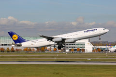 Lufthansa Airbus A340-300. Munich, Germany - October 24, 2013: A Lufthansa Airbus A340-300 with the registration D-AIGU takes off from Munich Airport (MUC) Royalty Free Stock Image