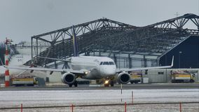 Lufthansa CityLine Embraer ERJ-195 D-AEMC. Lufthansa Airbus A320-200 plane taxiing in Munich Airport MUC, Germany. Winter with snow on runways stock video footage