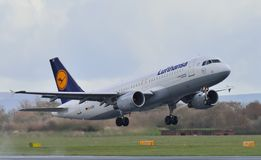 Lufthansa Airbus A320. Taking off from Manchester Airport royalty free stock photography