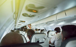 Lufthansa Airlines adventure travel inside plane with steward se Royalty Free Stock Images