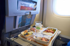 Lufthansa Boeing 747-400. NEW YORK - APRIL 06, 2016: meal in Economy Class of a  Lufthansa Boeing 747.  Lufthansa is a German airline and, when combined with its Royalty Free Stock Photos