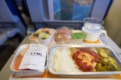 Lufthansa Boeing 747-400. NEW YORK - APRIL 06, 2016: meal in Economy Class of a  Lufthansa Boeing 747.  Lufthansa is a German airline and, when combined with its Royalty Free Stock Photo