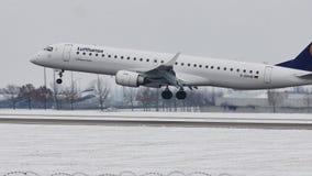 Lufthansa CityLine Embraer ERJ-195 D-AEMB in Munich Airport. Lufthansa CityLine Embraer ERJ-195 D-AEMB landing on snowy runway in Muenchen Flughafen, Germany stock video