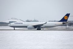 Lufthansa CityLine Embraer ERJ-195 D-AEMD landing in Munich Airport Royalty Free Stock Photo