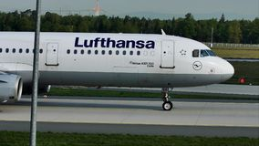 Lufthansa doing taxi in Frankfurt Airport, FRA. Germany stock footage