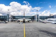 Lufthansa Flight at the gate in Frankfurt. FRANKFURT, GERMANY - JULY 25, 2015: Lufthansa Flight at the gate in Frankfurt, Germany. New Terminal A is under Stock Photography
