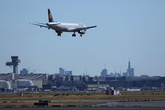 Lufthansa plane landing in Frankfurt Airport, FRA, buildings on background. Lufthansa in Frankfurt Airport, FRA, Germany stock image