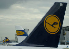 Lufthansa Historical Logo. Lufthansa showing in between historical airplane Stock Photography