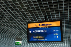 Lufthansa information monitor at Cracow International Airport. Stock Photography