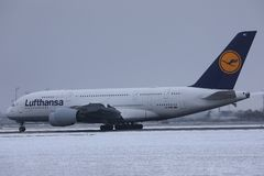 Lufthansa A380 plane doing taxi on snow, Munich Airport MUC stock photography