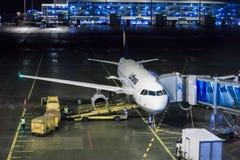 Lufthansa jet at night Stock Photo