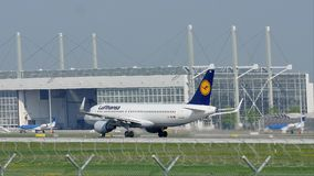 Lufthansa plane taking off from Munich Airport MUC. Lufthansa jet takes off from Munich Airport, MUC, spring stock video
